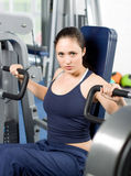 Young woman exercising in the gym Royalty Free Stock Photo