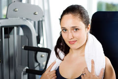Young woman exercising in the gym. Attractive young woman exercising in the gym Stock Photography