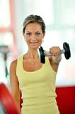 Young woman exercising in the gym Royalty Free Stock Image