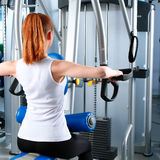 Young woman exercising at the gym Stock Photography