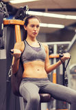 Young woman exercising on gym machine Royalty Free Stock Photos