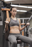 Young woman exercising on gym machine Royalty Free Stock Photography
