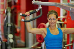 Young woman exercising in the gym Royalty Free Stock Photography