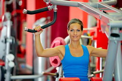 Young woman exercising in the gym Stock Image
