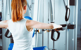 Young woman exercising at the gym Stock Photo