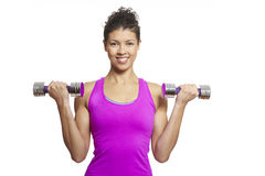 Young woman exercising holding dumbbells Stock Images