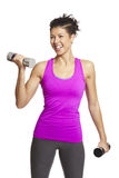 Young woman exercising holding dumbbells Stock Photography