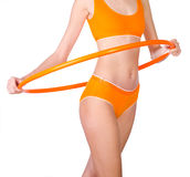 Young woman exercising with hula hoop Royalty Free Stock Photos