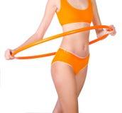 Young woman exercising with hula hoop Royalty Free Stock Photos