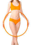 Young woman exercising with hula hoop Stock Photos