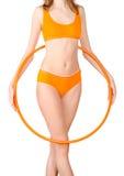 Young woman exercising with hula hoop Stock Photos
