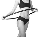 Young woman exercising with hula hoop Royalty Free Stock Photography