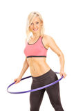 Young woman exercising with a hula hoop Royalty Free Stock Photos