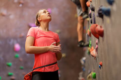 Young woman exercising at indoor climbing gym Stock Image