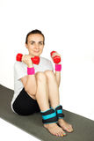 Young woman exercising, isolated Stock Photos