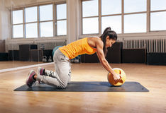 Young woman exercising with kettle bell Royalty Free Stock Photography