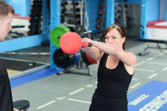 Young woman exercising with kettle bell weight Stock Photography
