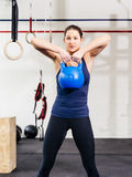Young woman exercising with kettlebell Stock Photography