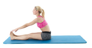 Young woman exercising on mat Royalty Free Stock Photography