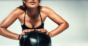 Young woman exercising with medicine ball Stock Photo