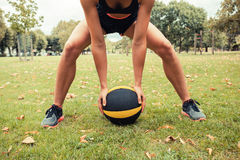 Young woman exercising with medicine ball in park Royalty Free Stock Image