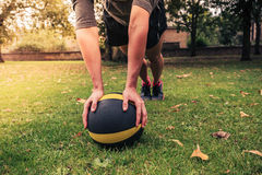 Young woman exercising with medicine ball in park Stock Image