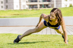 Young Woman exercising out door at the park Stock Photography