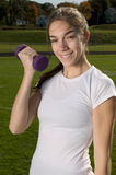 Young woman exercising outdoors Royalty Free Stock Photography