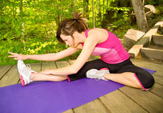 Young Woman Exercising Outdoors Stock Image