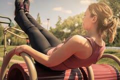 Young woman exercising outdoors. Stock Photos