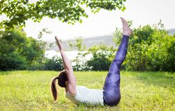 Young woman exercising outdoors in nature. Beautiful handsome young woman exercising outdoors in nature, healthy lifestyle Stock Photos