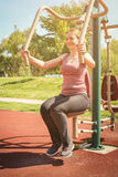 Young woman exercising outdoors. Royalty Free Stock Image