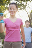 Young Woman Exercising in Park with Dumbells Stock Photos