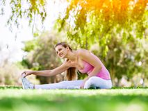 Young woman exercising in the park Royalty Free Stock Images