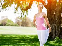 Young woman exercising in the park Royalty Free Stock Photography