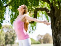 Young woman exercising in the park Stock Photography