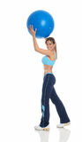 Young woman exercising with a pilates ball Royalty Free Stock Images
