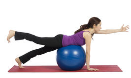 Young woman exercising with a pilates ball Royalty Free Stock Photography
