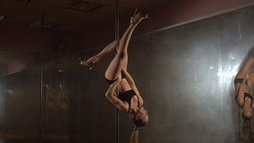 Young woman exercising pole dance fitness, upside down. Slow motion. stock video