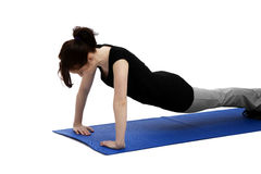 Young woman exercising press ups Royalty Free Stock Image
