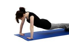 Young woman exercising press ups Royalty Free Stock Image