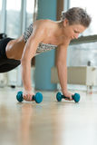 Young Woman Exercising Push Ups Stock Photo