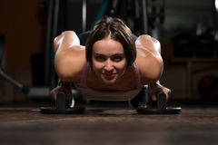 Young Woman Exercising Push Ups On Floor Stock Photo