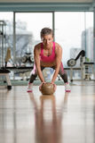Young Woman Exercising Push Ups On Medicine Ball Stock Photo