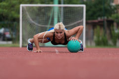 Young Woman Exercising Push-Ups On Medicine Ball Outdoor Royalty Free Stock Photo