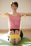 Young Woman Exercising with Resistance Bands Royalty Free Stock Photo