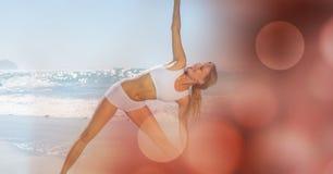 Young woman exercising on shore Stock Photos