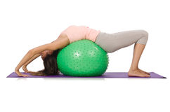 Young woman exercising with swiss ball Stock Images
