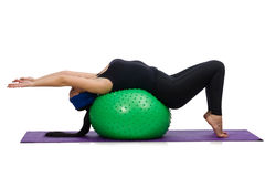 Young woman exercising with swiss ball Stock Photography