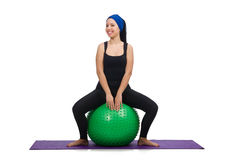 Young woman exercising with swiss ball Royalty Free Stock Image